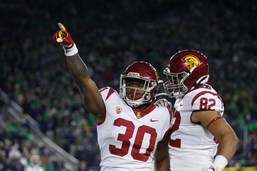 USC running back Markese Stepp (30) celebrates after scoring on a two-yard touchdown run in the second half against Notre Dame in South Bend, Ind. on Saturday.