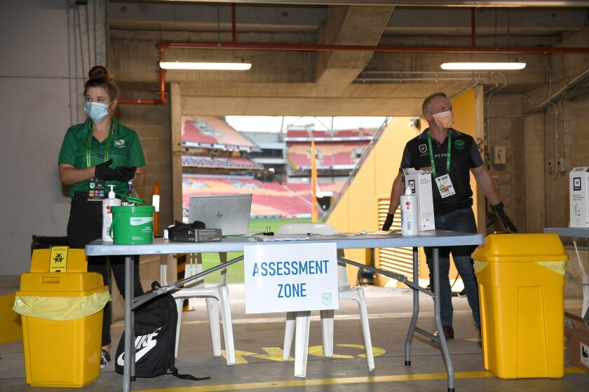 An area is set aside to test people arriving before the Brisbane Broncos and Parramatta Eels of the National Rugby League play, Thursday, May 28, 2020, in Brisbane, Australia. Two rounds of matches were played in the NRL in March before Australia and New Zealand went into lockdown and closed borders in a bid to slow the spread of COVID-19. (Scott Davis/NRL Photos via AP)