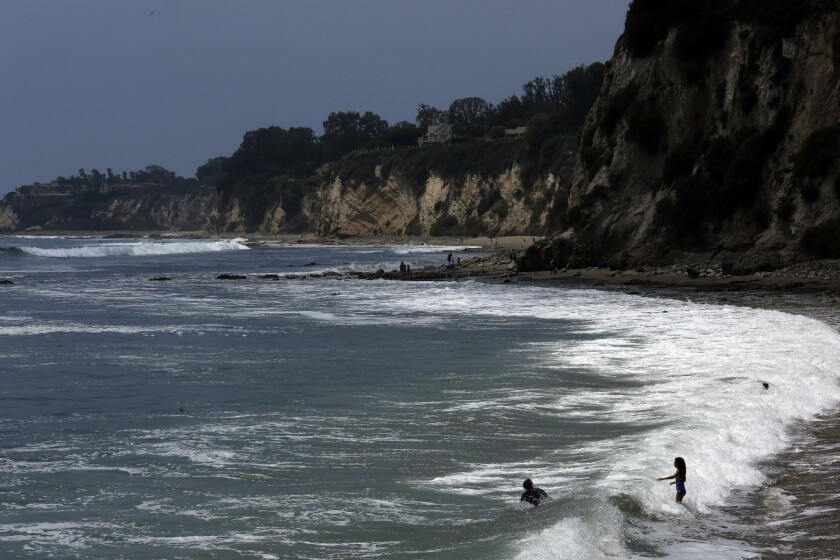 Children play in the surf at Paradise Cove in Malibu. Public access to the beach was blocked for the second time in two years, even though the surf is a public area under California's Constitution.