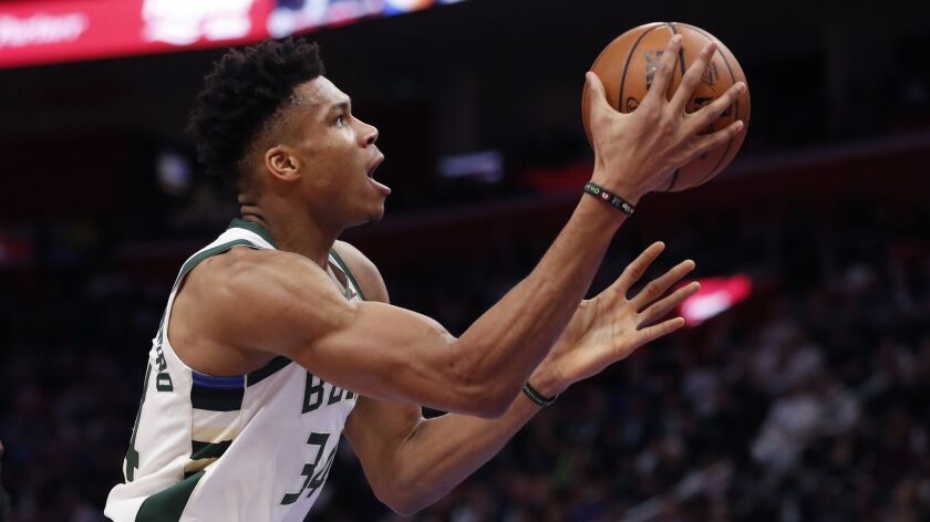 Bucks forward Giannis Antetokounmpo makes a layup during a playoff game against the Detroit Pistons on April 22, 2019, in Detroit.