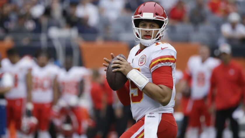FILE - In this Aug. 25, 2018, file photo, Kansas City Chiefs' Patrick Mahomes looks for a receiver d