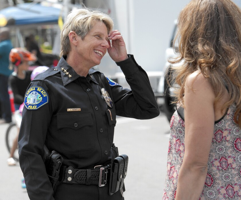 Laguna Beach Police Chief Laura Farinella talks with a resident at an event in 2015, the year she stepped into her role. She now plans to retire in July.