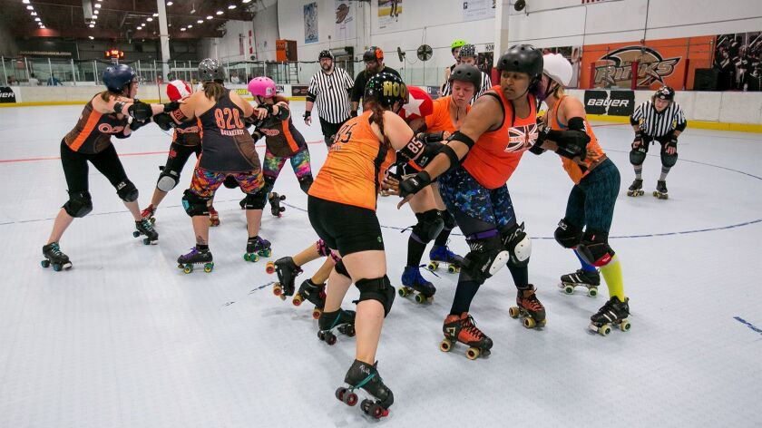 Members of the Orange County Roller Derby league practice at The Rinks in Huntington Beach on Monday