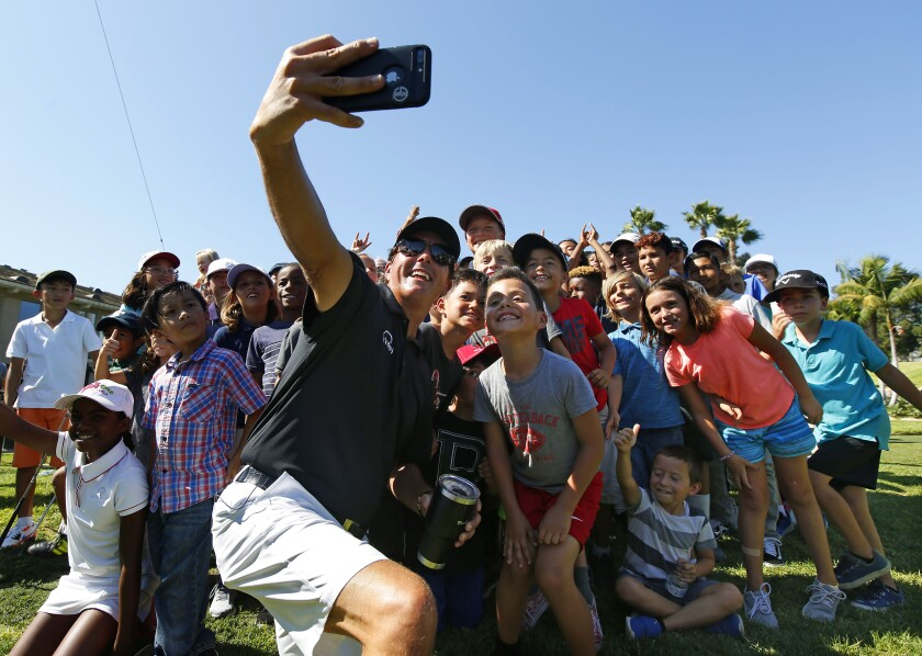 Phil Mickelson, shown Thursday during the Pro Kids |The First Tee of San Diego clinic Thursday at Colina Park Golf Course, has started revealing his humorous side on social media.