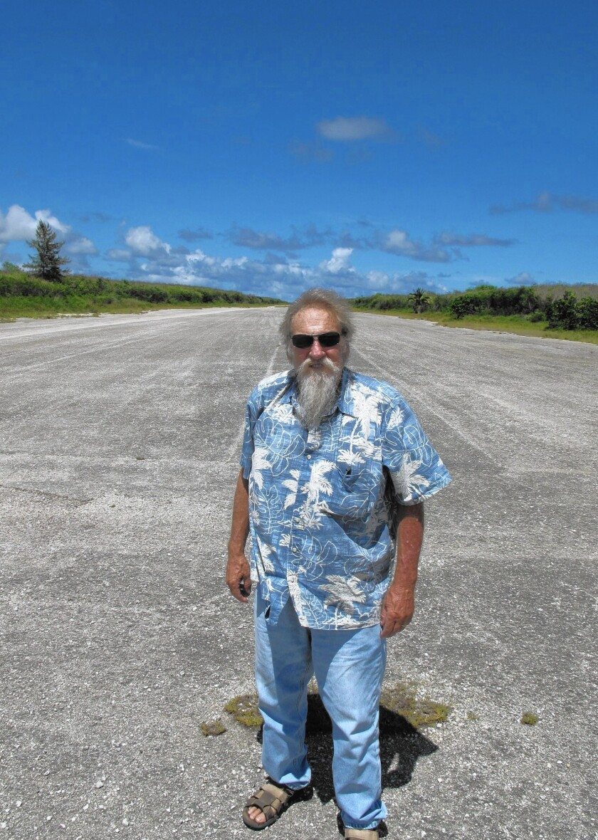 Former Newport Beach resident Don Farrell stands on historic Runway Able on Tinian's North Field from where two U.S. Army Air Force B-29s flew to Japan and dropped atomic bombs on Hiroshima and Nagasaki in August, 1945.