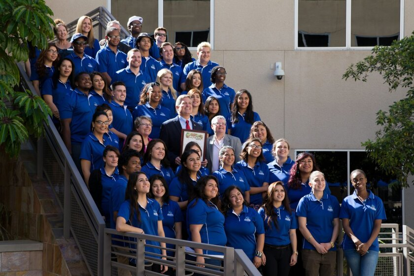 County Supervisor Dave Roberts (center) joins Jan and Esther Stearns for a photo with CSUSM's ACE Scholars.