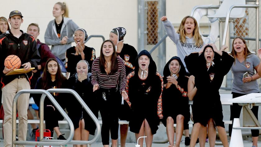 Huntington Beach High girls' water polo players react after Chloe Reiner (not pictured) ties the gam