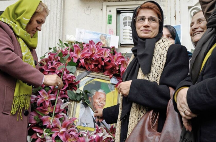 """Iranian human rights lawyer-activist Nasrin Sotoudeh with a portrait of Nelson Mandela in the documentary """"Nasrin."""""""