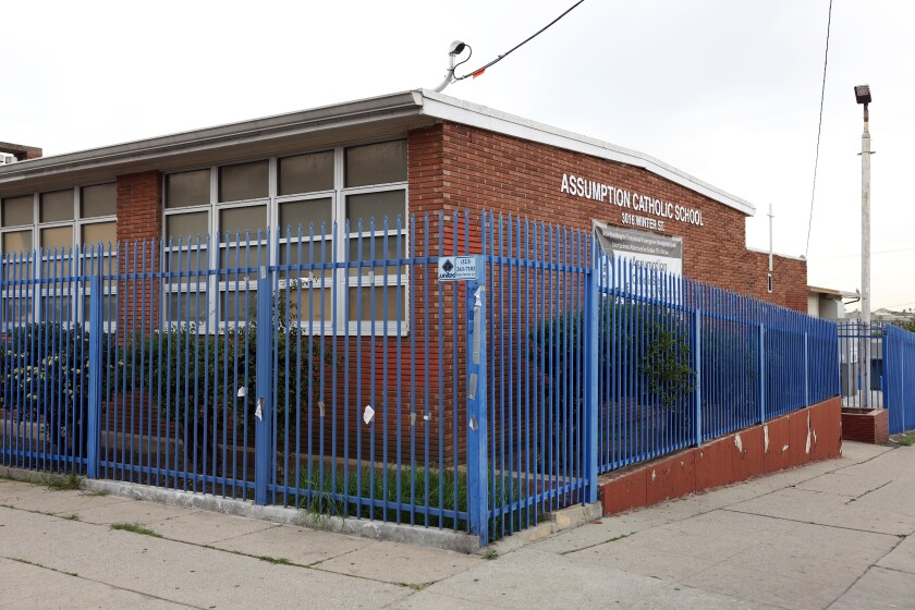 Blue fencing surround Assumption Catholic School in Boyle Heights.