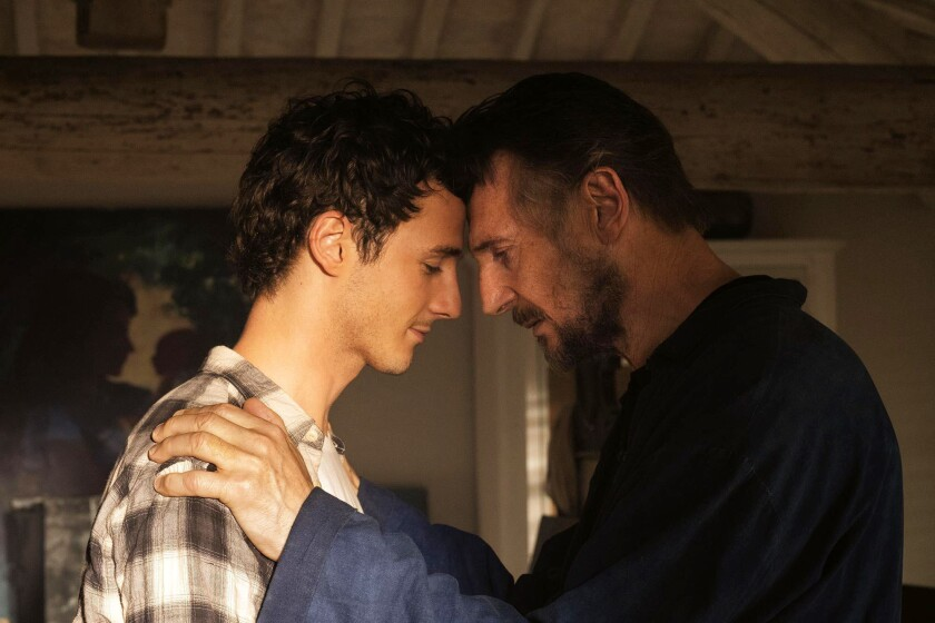 """This image released by IFC Films shows Michaél Richardson, left, and his father Liam Neeson in a scene from """"Made In Italy."""" They play father and son in the film but their characters are dealing with the loss of their wife and mother. Neeson's wife and Richardson's mother, Natasha Richardson, died over a decade ago in a skiing accident. (IFC Films via AP)"""