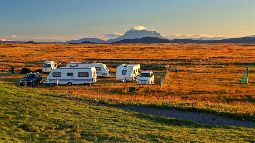 Early evening sunlight floods the highlands between the oasis farm of Möðrudalur and Mount Herðubreið.