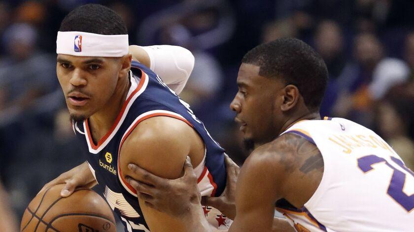 LA Clippers forward Tobias Harris, left, looks to pass as Phoenix Suns forward Josh Jackson (20) def