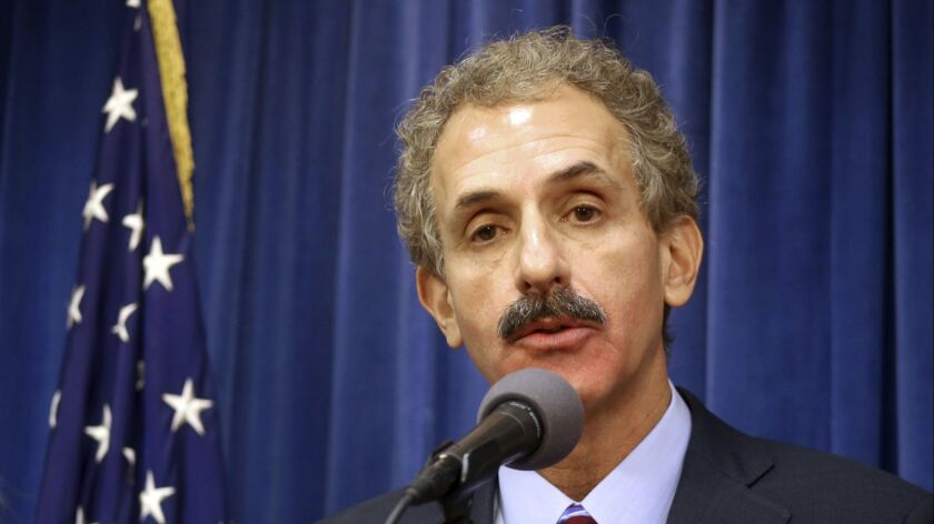 Los Angeles City Atty. Mike Feuer is going after the big tax-preparation companies, accusing them of concealing free services from their customers.