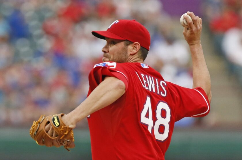Texas Rangers pitcher Colby Lewis throws against the Chicago White Sox in the first inning of a baseball game in Arlington, Texas, Saturday, April 19, 2014. (AP Photo/Dallas Morning News, Louis DeLuca) MANDATORY CREDIT; NO SALES; MAGAZINES OUT; TV OUT; INTERNET USE BY AP MEMBERS ONLY
