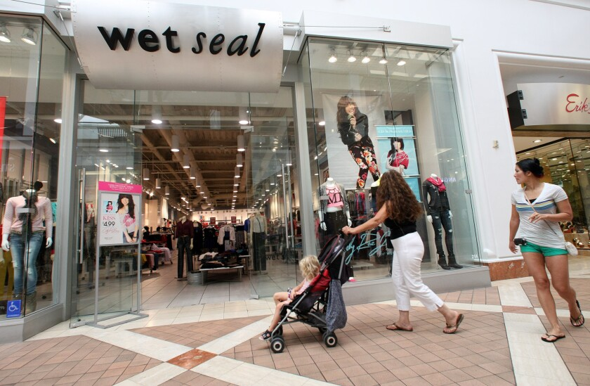 Shoppers walk past a Wet Seal store at Fashion Square Mall in Sherman Oaks in September 2012.