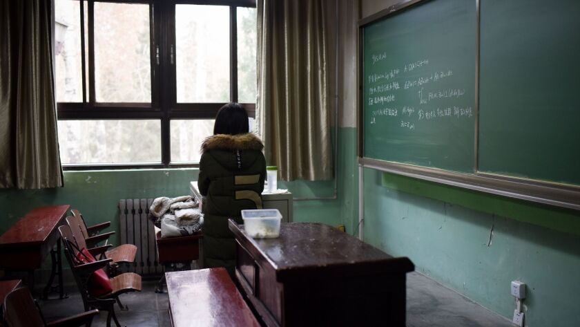 A female student in a classroom at Beijing's Beihang University, where the vice director of the graduate school was stripped of his position after an investigation determined that he had sexually harassed multiple students.