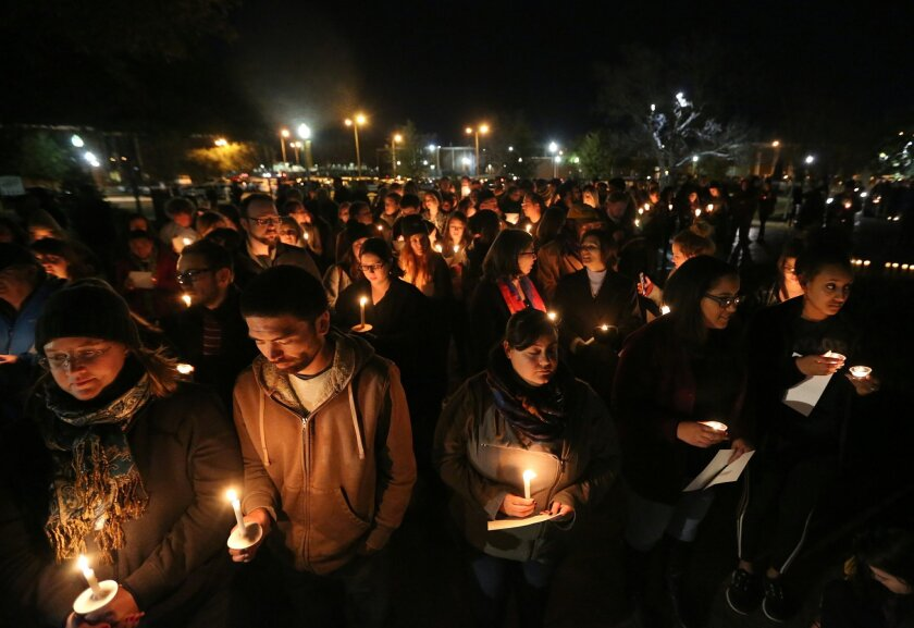 "FILE - In this Monday, Feb. 8, 2016 file photo, Baylor students and alumni hold a candlelight vigil outside the home of Baylor University President Ken Starr in what organizers' call a ""Survivors' Stand"" in Waco, Texas. The event was held in an effort to urge changes to how the school handles sexua"