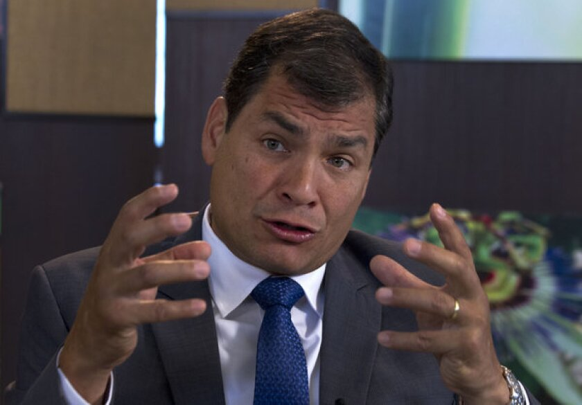 Ecuador's President Rafael Correa speaks during an interview Sunday with Associated Press in Portoviejo, Ecuador. Correa said Edward Snowden must assume responsibility if he broke U.S. laws.