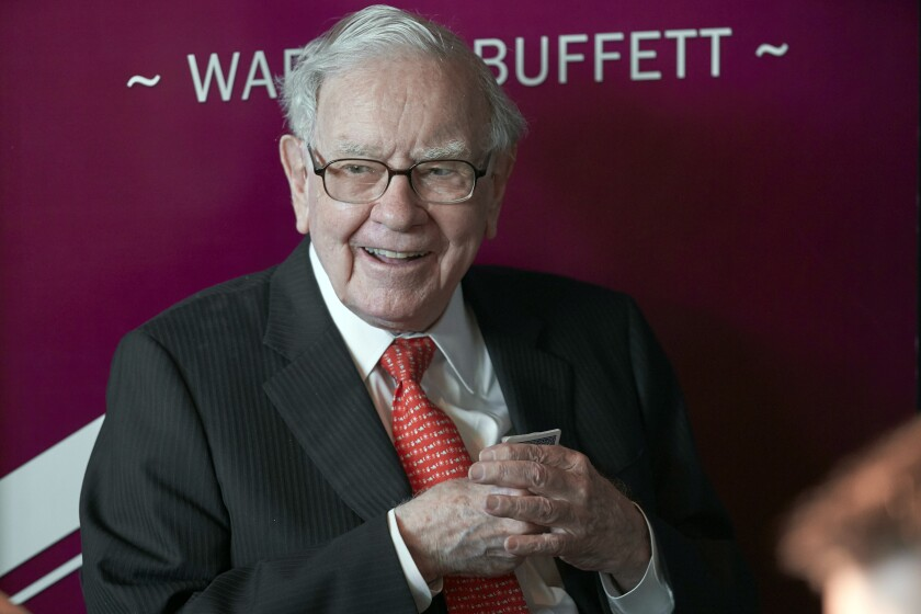 FILE - In this May 5, 2019, file photo Warren Buffett, Chairman and CEO of Berkshire Hathaway, smiles as he plays bridge following the annual Berkshire Hathaway shareholders meeting in Omaha, Neb. Buffett's company is abandoning its purchase of a natural gas pipeline from Dominion Energy because of uncertainty about whether the deal could get regulatory approval. Berkshire Hathaway Inc. will receive a $1.3 billion refund on the proposed purchase of Questar Pipelines that was also supposed to include $430 million of Dominion's debt when it was announced a year ago. (AP Photo/Nati Harnik, File)