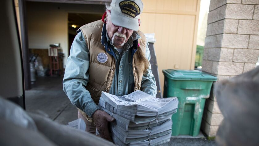 QUINCY, CALIF. - DECEMBER 13: Scott McDermid loads freshly printed copies of The Mountain Messenger,