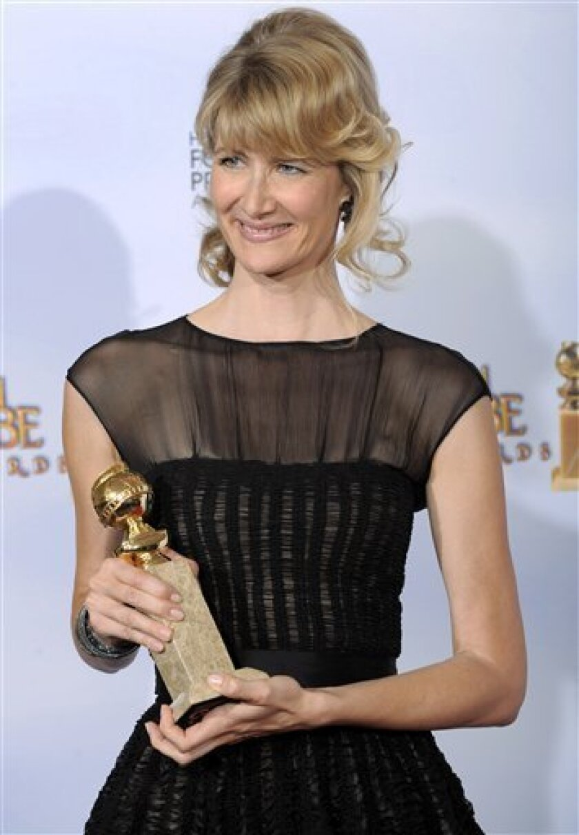 Laura Dern poses backstage with the award for best actress in a supporting role in a series, miniseries or motion picture made for television for her role in �Recount� at the 66th Annual Golden Globe Awards on Sunday, Jan. 11, 2009, in Beverly Hills, Calif. (AP Photo/Mark J. Terrill)
