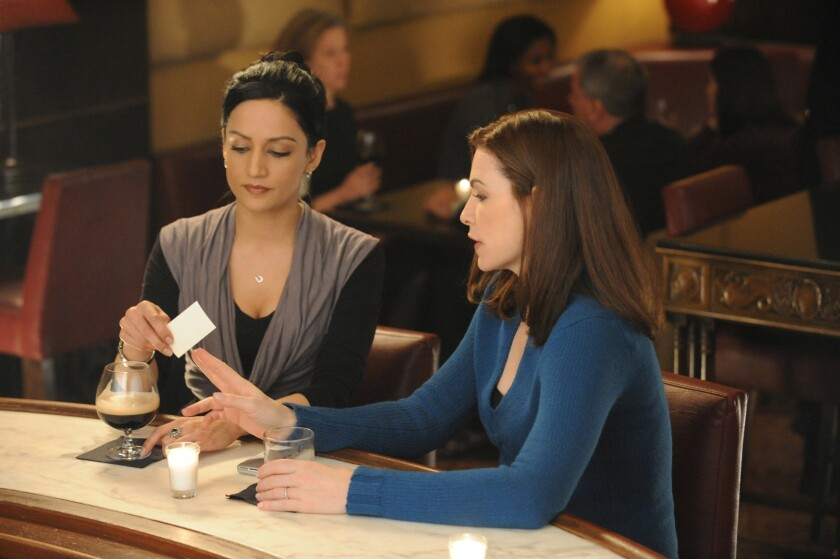 """Julianna Margulies, right, as Alicia and Archie Panjabi as Kalinda in a scene from """"The Good Wife"""" in 2010. Don't ask CBS entertainment chief Nina Tassler about the Alicia-Kalinda goodbye scene in the Season 6 finale."""