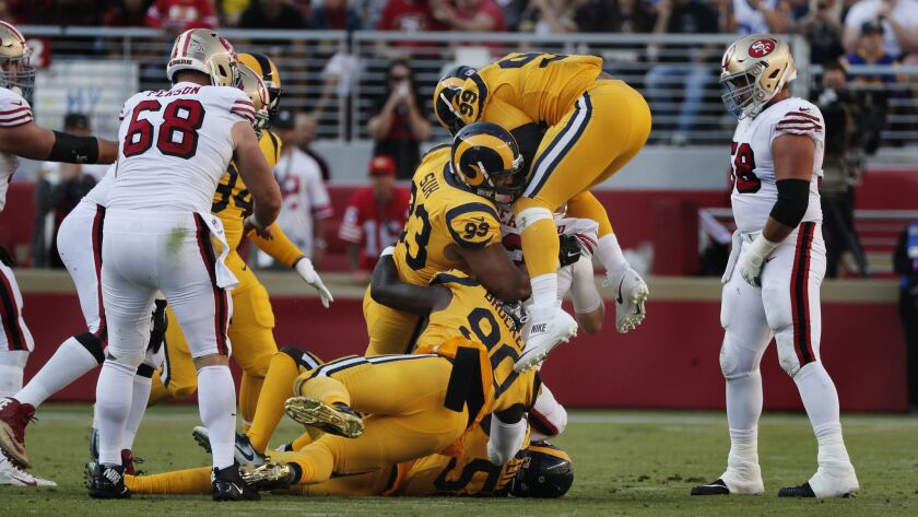 LOS ANGELES, SEPTEMBER 27, 2018-Rams Ndamukong Suh (93) and Aaron Donald celebrate a fumble recovery
