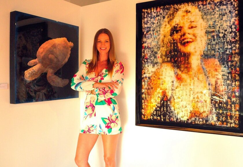 Elisabeth King, co-owner/curator of The La Jolla Gallery, with some of the art available for sale.