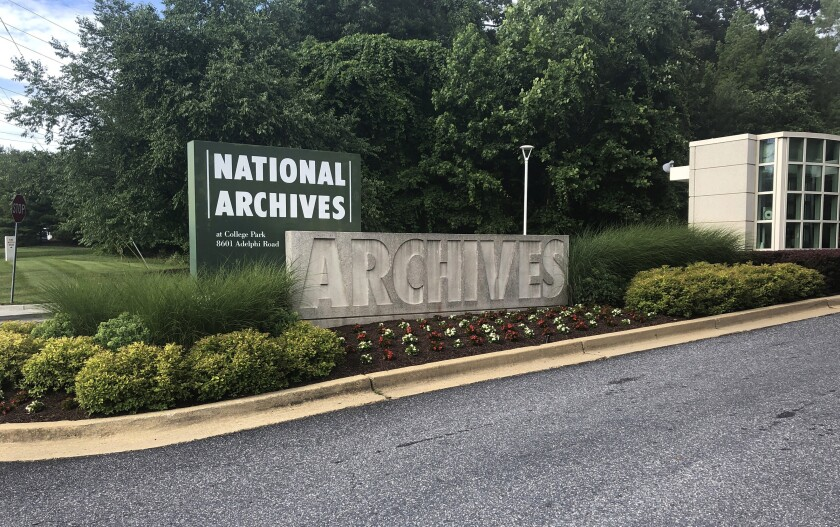 FILE - This June 18, 2019, file photo shows a sign for the entrance to the National Archives in College Park, Md. A Virginia National Guard sergeant accused of stealing World War II-era dog tags from the National Archives and Records Administration in Maryland has pleaded guilty to a theft charge. (AP Photo/Michael Kunzelman, File)