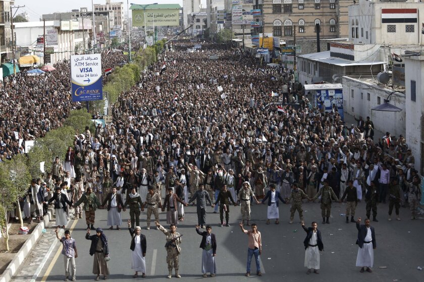 Shiite rebels known as Houthis hold a rally to denounce the Saudi-led airstrikes during a protest in Sana, Yemen, on Monday.