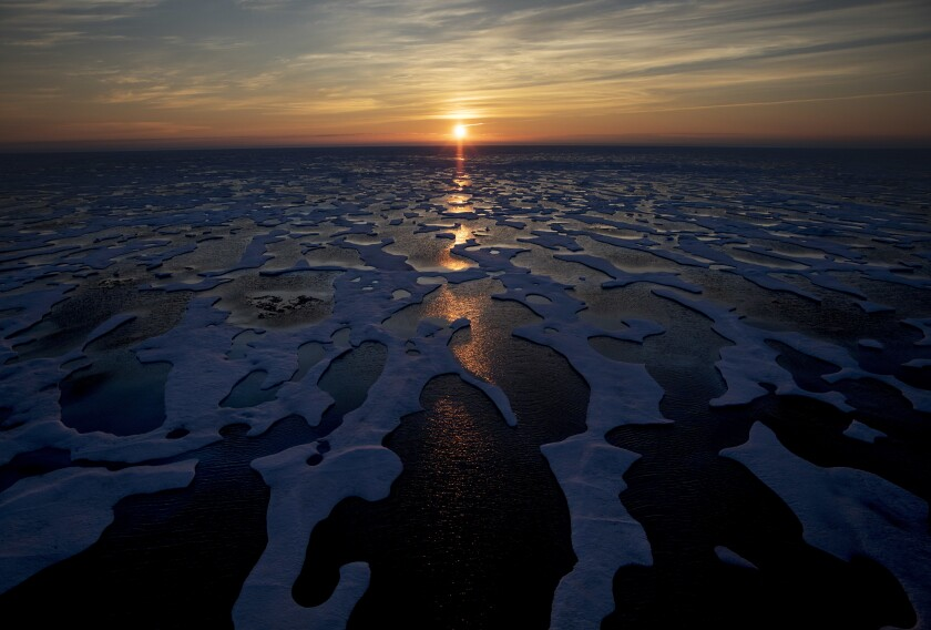 FILE - In this July 22, 2017, file photo the midnight sun shines across sea ice along the Northwest Passage in the Canadian Arctic Archipelago. The Biden administration is stepping up its work to figure about what to do about the thawing Arctic, which is warming three times faster than the rest of the world. The White House said Friday, Sept. 24, 2021, that it is reactivating the Arctic Executive Steering Committee, which coordinates domestic regulations and works with other Arctic nations. It also is adding six new members to the U.S. Arctic Research Commission, including two indigenous Alaskans. (AP Photo/David Goldman)