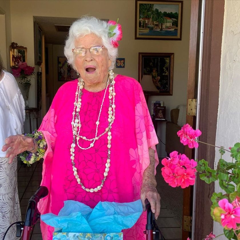 Christinia Lee gets a surprise hula dance and drive-by party for her 102nd birthday.