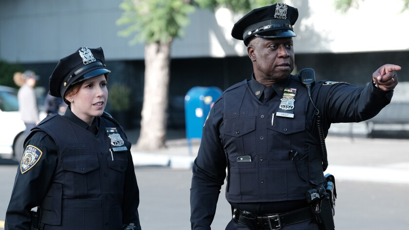 """Vanessa Bayer joins the cast in the season premiere of the police comedy """"Brooklyn Nine-Nine"""" on NBC. With Andre Braugher."""