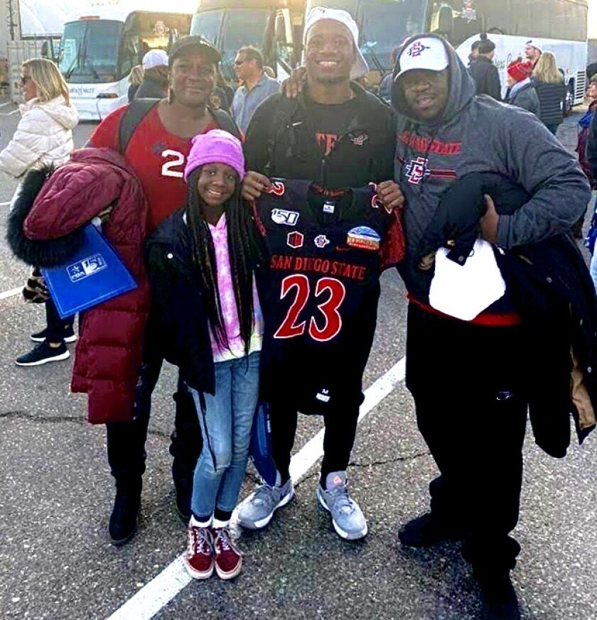 Aztecs cornerback Darren Hall is shown with his mother Shannon, sister Melodee and father Art at the 2019 New Mexico Bowl.