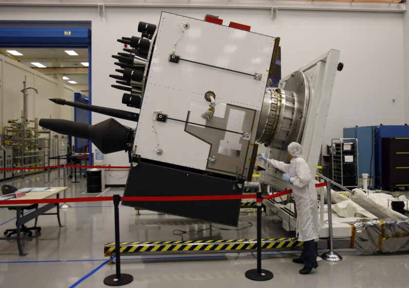 A technician inspects a GPSIIF satellite being built at Boeing's El Segundo facility in 2010.