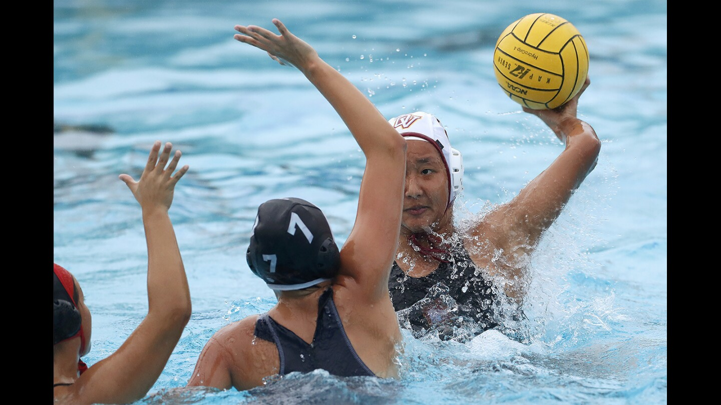 Ocean View's Leyna Tran looks for an open shot against Segerstrom's Liz Fuentes, left, and Faith Cueva, center, during a game on Tuesday, January 9.