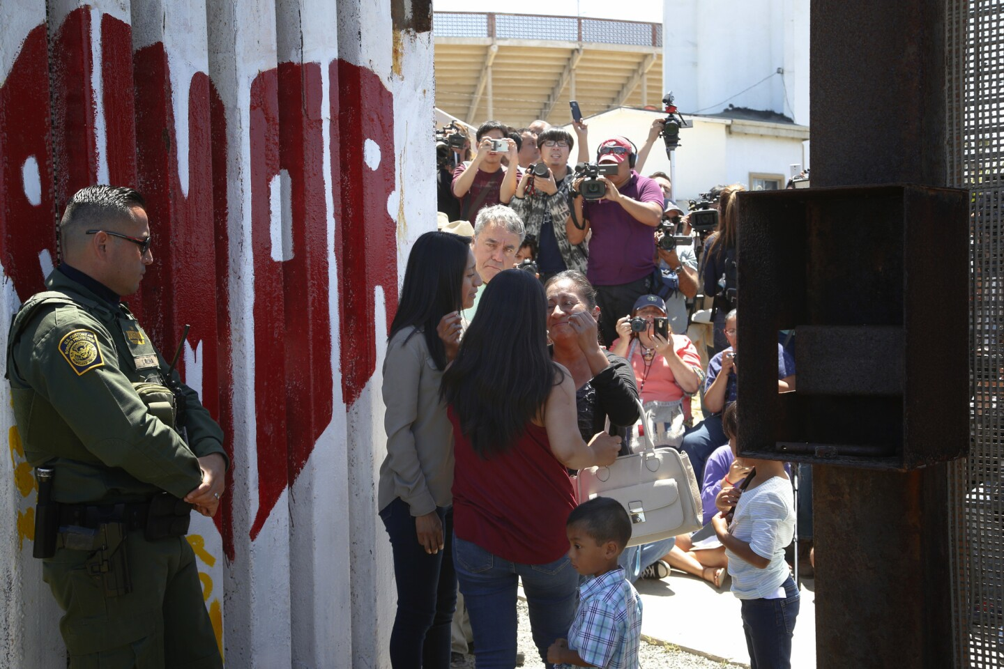 At Border Field State Park on Sunday, families north of the border were allowed to briefly meet with loved ones living in Mexico through an open gate.