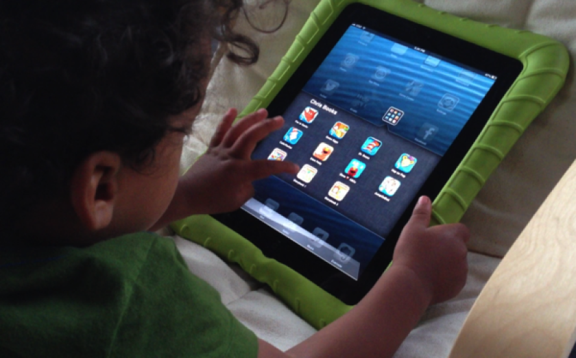Christopher, soon to be 2 years old, is proficient at navigating his mom's iPad -- but not without taking out a few apps in the process.