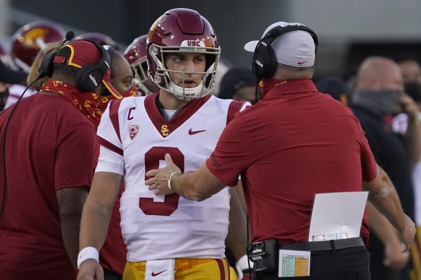 USC quarterback Kedon Slovis speaks with coach Clay Helton during a win over Arizona on Nov. 14.