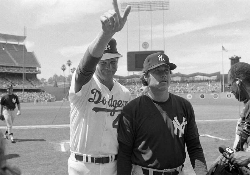 Dodgers pitcher Jerry Reuss stands with the Yankees' Goose Gossage at the 1980 All-Star game at Dodger Stadium.