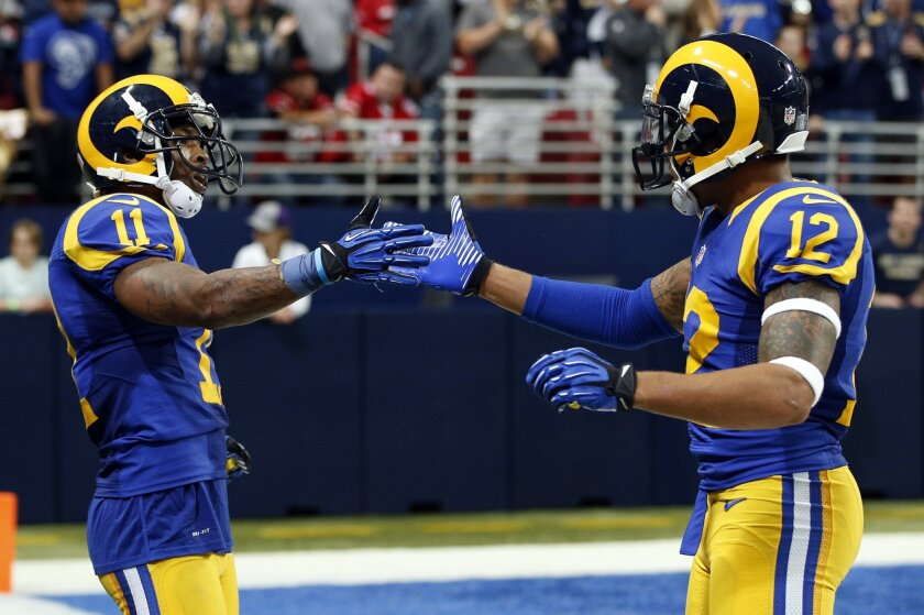St. Louis Rams wide receiver Tavon Austin,  left, is congratulated by teammate Stedman Bailey, right, after catching a short pass and running it in for a touchdown during the fourth quarter of an NFL football game against the San Francisco 49ers, Sunday, Nov. 1, 2015, in St. Louis. (AP Photo/Billy