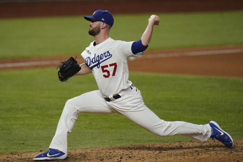 Los Angeles Dodgers pitcher Alex Wood throws against the Tampa Bay Rays during the seventh inning in Game 2 of the baseball World Series Wednesday, Oct. 21, 2020, in Arlington, Texas. (AP Photo/Eric Gay)