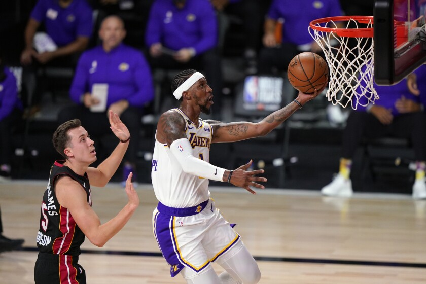 Lakers guard Kentavious Caldwell-Pope beats Heat forward Duncan Robinson for layup during Game 6 of the NBA Finals.