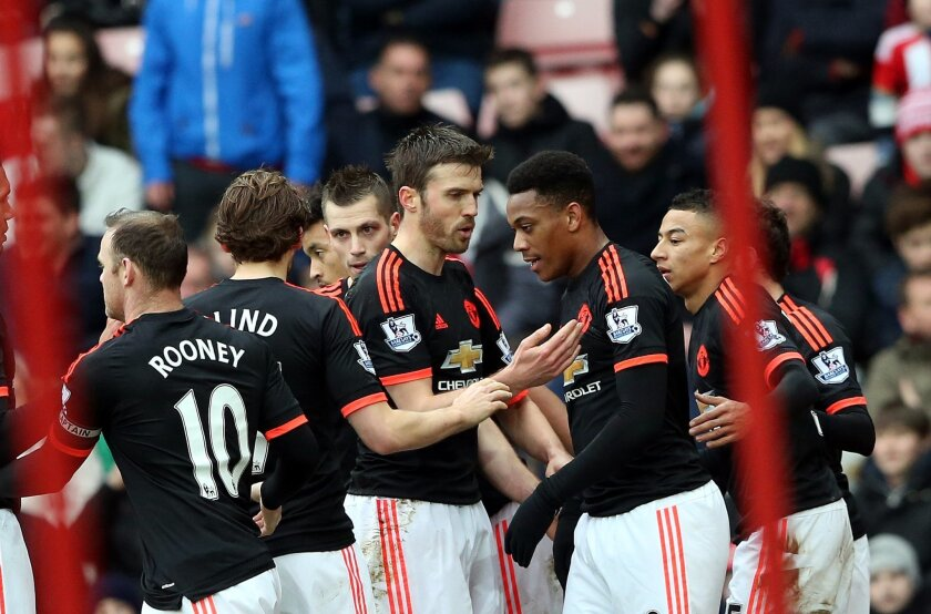 Manchester United's Anthony Martial, second right, celebrates his goal with his teammates during the English Premier League soccer match between Sunderland and Manchester United at the Stadium of Light, Sunderland, England, Saturday, Feb. 13, 2016. (AP Photo/Scott Heppell)