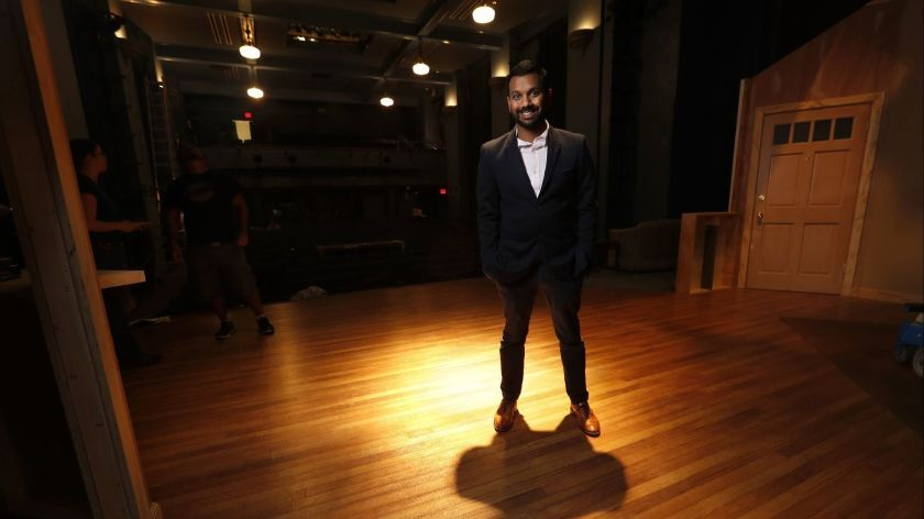 Snehal Desai, artistic director of East West Players, photographed on an empty stage.
