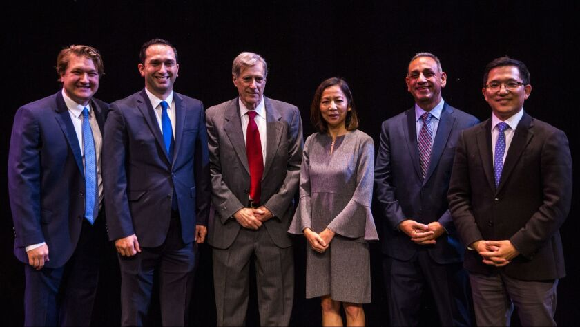 Phil Janowicz, Sam Jammal, Andy Thorburn, Mai-Khanh Tran, Gil Cisneros and Jay Chen at a forum for Democratic candidates in the 39th Congressional District in January. Janowicz and Chen have since dropped out.