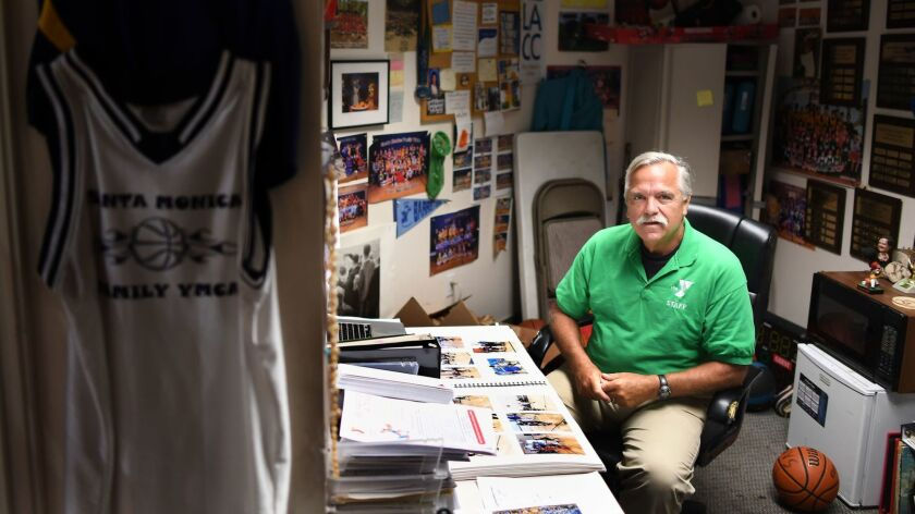 Longtime USC announcer Peter Arbogast in his office at the Santa Monica YMCA where he is a youth sports coordinator.