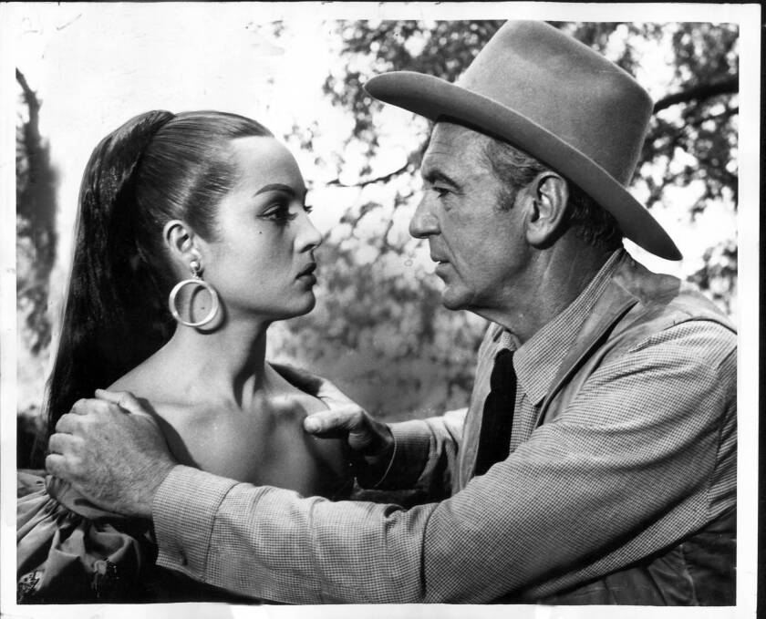 "Sara Montiel, left, a famed, sultry-voiced Spanish actress who achieved Hollywood stardom in the 1950s, appears in a scene with Gary Cooper from the legendary 1955 western ""Vera Cruz."""