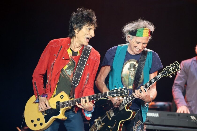 Ronnie Wood, left, and Keith Richards on guitar as The Rolling Stones perform live at Mount Smart Stadium Nov. 22, 2014 in Auckland, New Zealand.