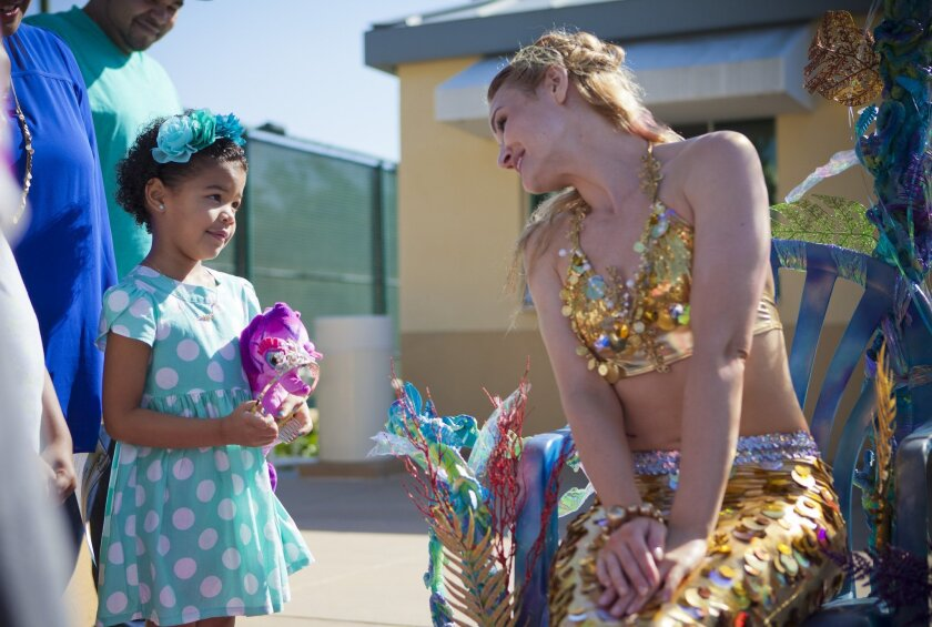 San Diego, Ca, USA, Sunday, November 03, 2013._ 5-yr-old Kaia Foster of Rancho Penasquitos has kidney cancer and the Make-a-Wish Foundation has granted her wish to become a mermaid.  Mermiad, Glimmer, sings Kaia a song.  PHOTO BY CRISSY PASCUAL/©2013 INFINITE MEDIA WORKS